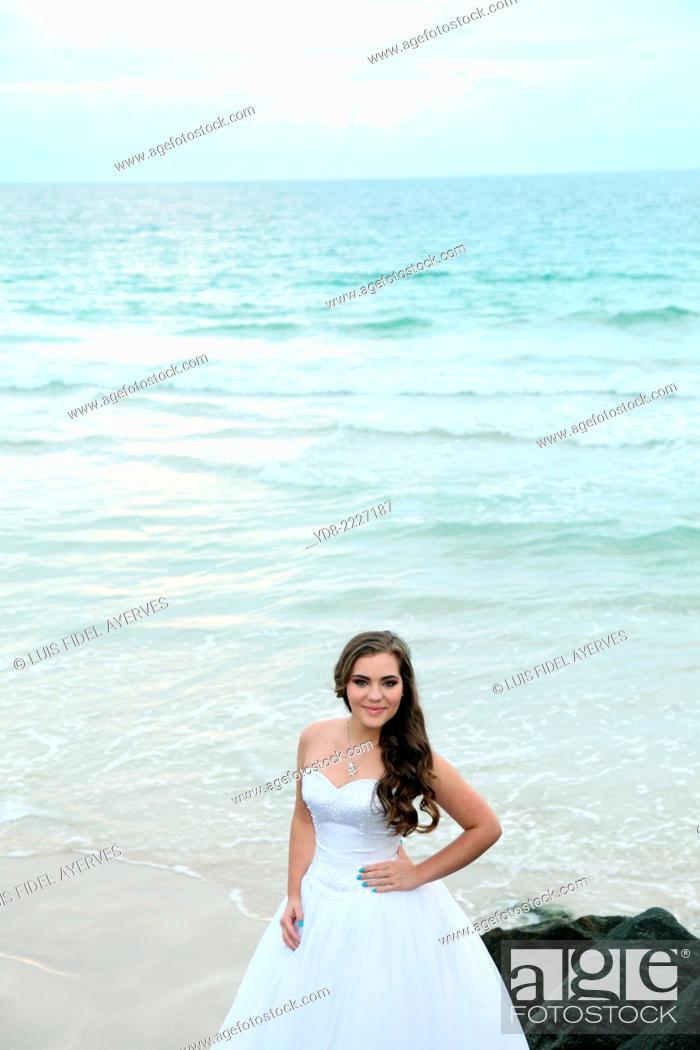 Stock Photo: Young Quinceañera in Miami Beach at sunrise, FLorida, USA.