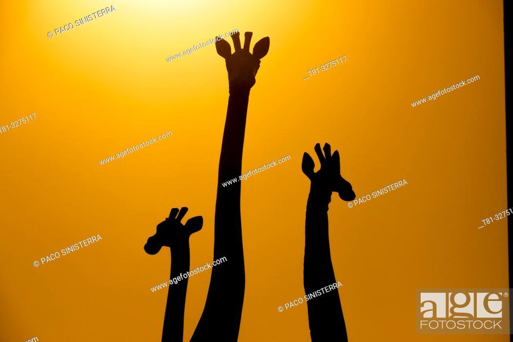 Stock Photo: Giraffe sculptures, silhouettes, Spain.
