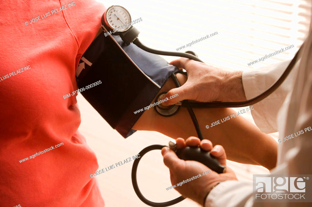 Stock Photo: Overweight woman having her blood pressure checked.