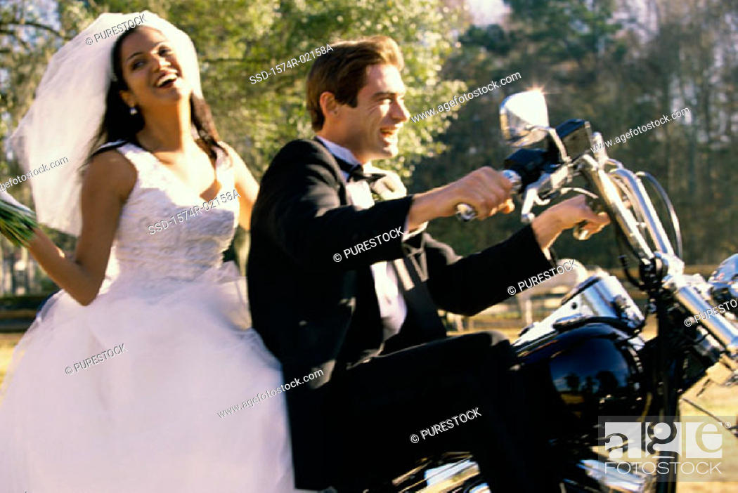 Stock Photo: Newlywed couple riding on a motorcycle.