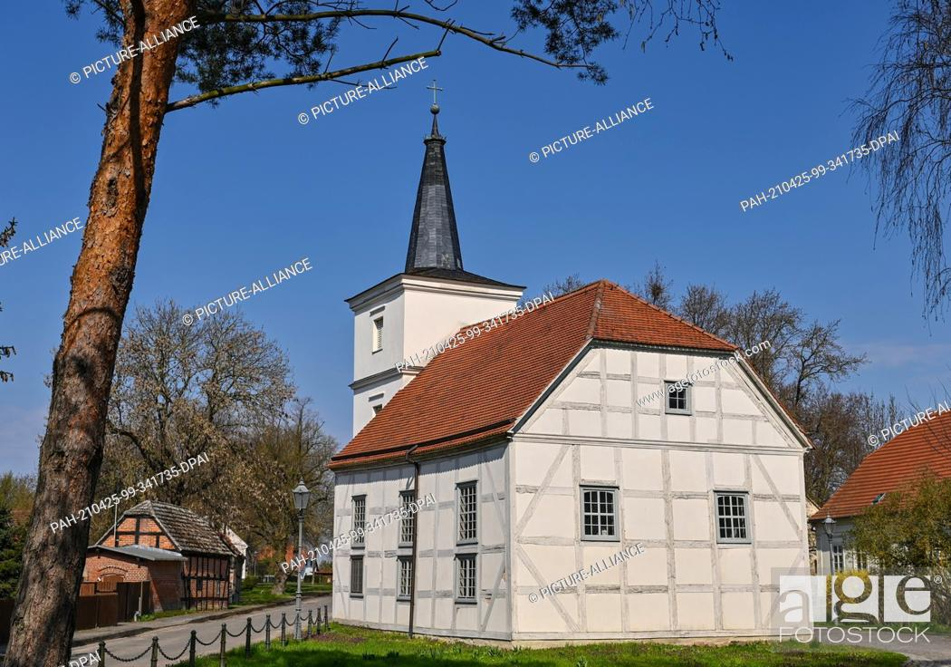 Stock Photo: 20 April 2021, Brandenburg, Altwustrow: The half-timbered church of Altwustrow. The fact that the small, listed half-timbered church in the Oderbruch village of.