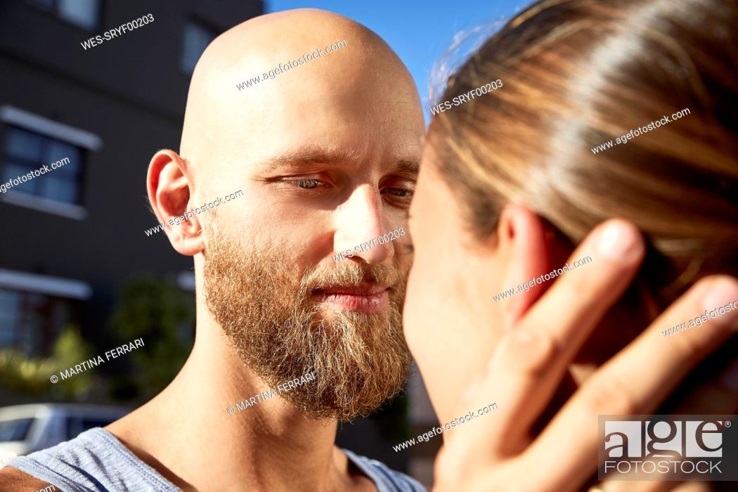 Stock Photo: Portrait of bald young man face to face with his girlfriend.