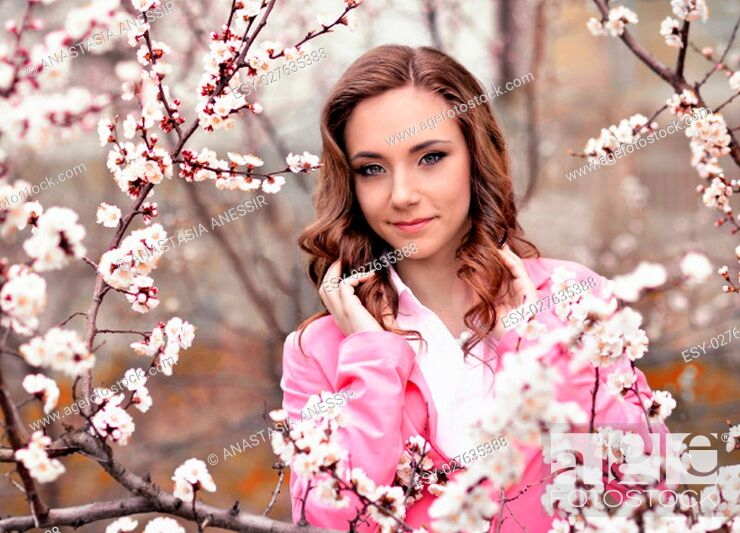 Stock Photo: Pretty, gentle, soft, cute, sweet, nice, relax, peaceful, happy, lonely, vivid, smiling, gorgeous very beautiful girl, garden full of flowering apples, cherries.