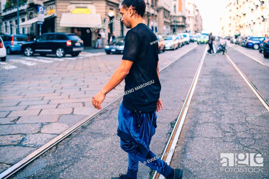 Stock Photo: Young man exploring city, Milano, Lombardia, Italy.