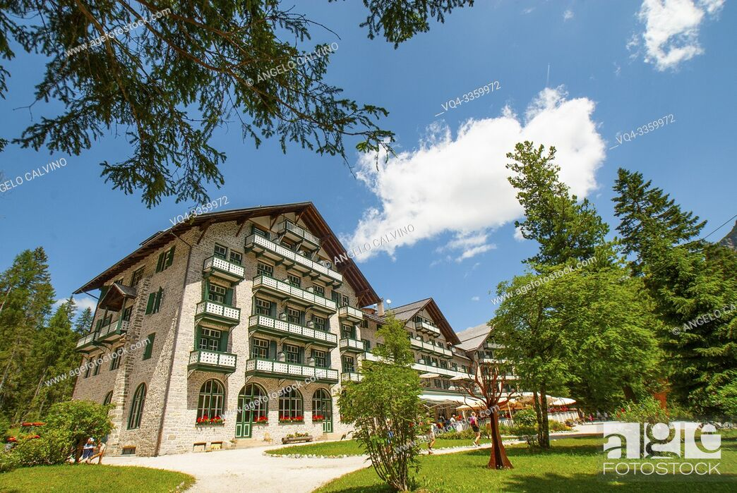 Stock Photo: Hotel and Restaurant near Turquoise water of the lake Lago di Braies, Pragser Wildsee surrounded by pine forest and mountains in the Prags Dolomites in South.