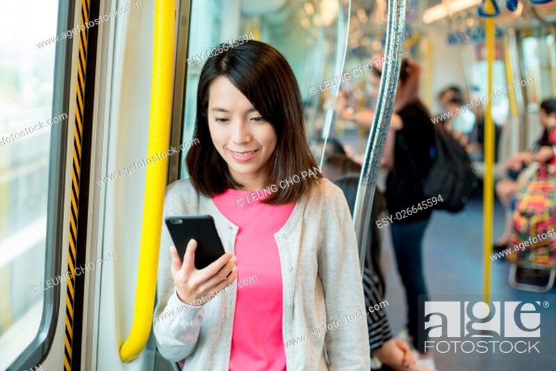 Stock Photo: Woman use of mobile phone at train compartment.