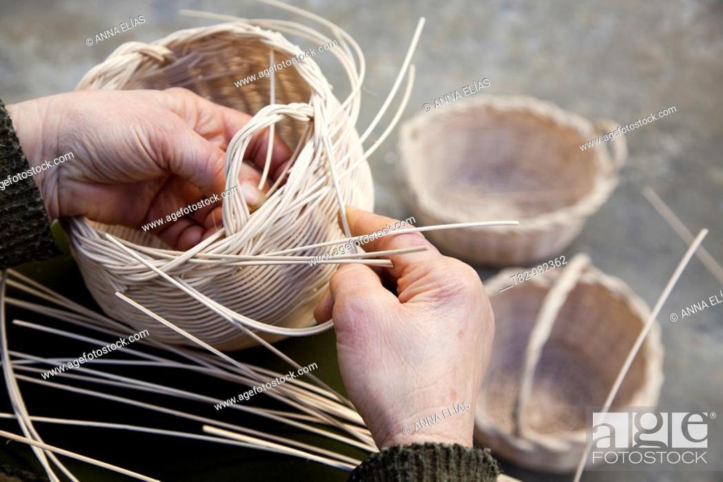 Stock Photo: woman's hands making wicker baskets in the Sierra de Aracena, Huelva,manos de mujer haciendo canastos de mimbre en la Sierra de Aracena, Huelva.