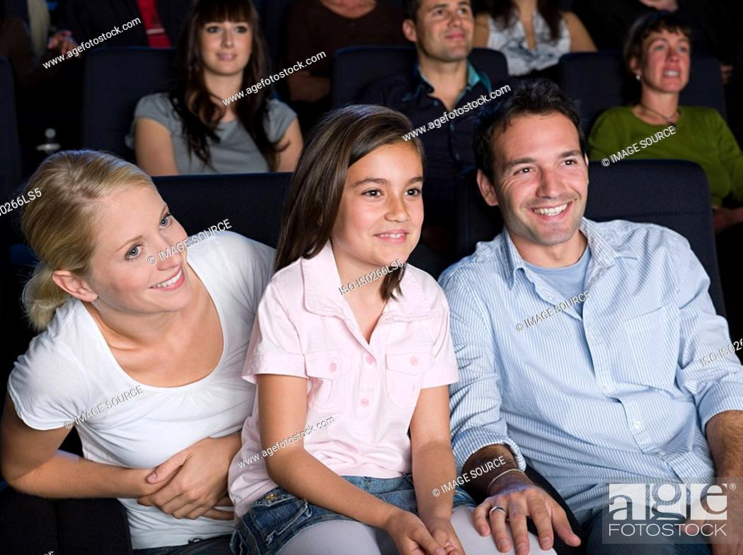Stock Photo: A family watching a movie.