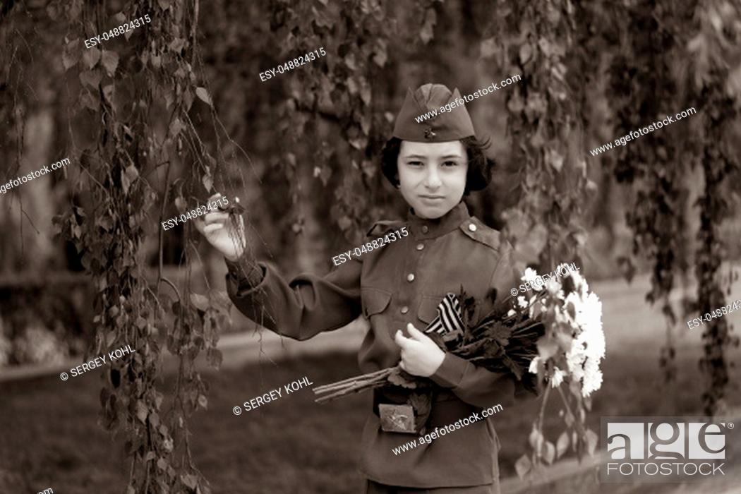 Imagen: Portrait of a boy with flowers, in the uniform of a soldier of the Red Army during the Second World War. Stylization. Sepia.