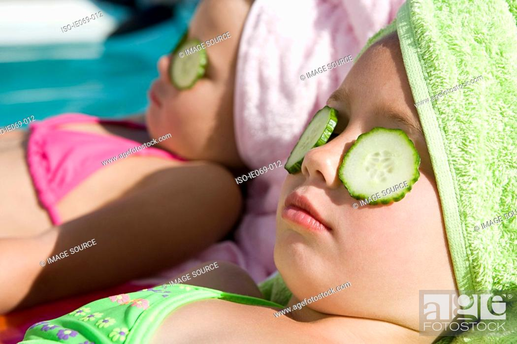 Stock Photo: Girls with cucumber slices on eyes.