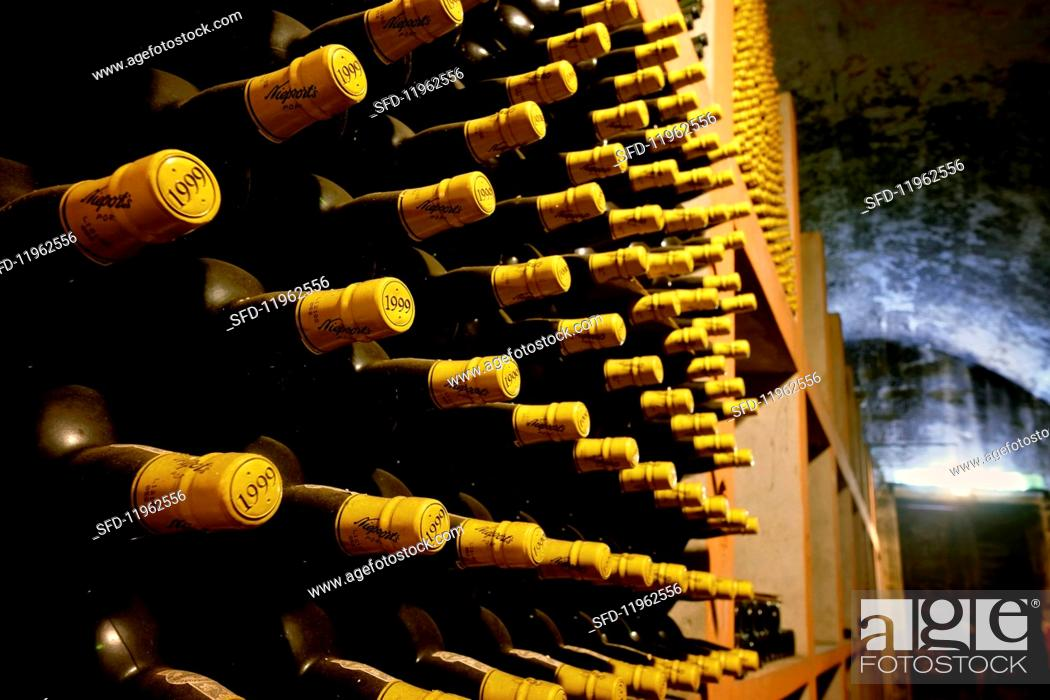 Stock Photo: Bottles stored in a cellar at the Niepoort winery, Portugal.