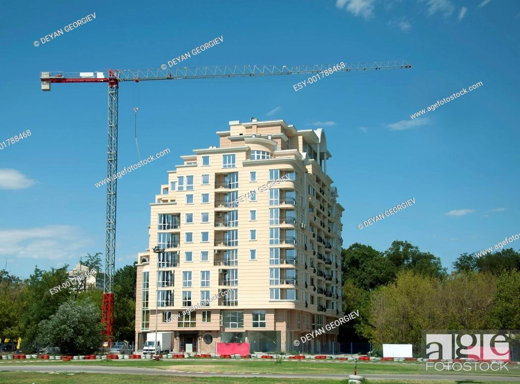 Stock Photo: Construction crane and a new building.
