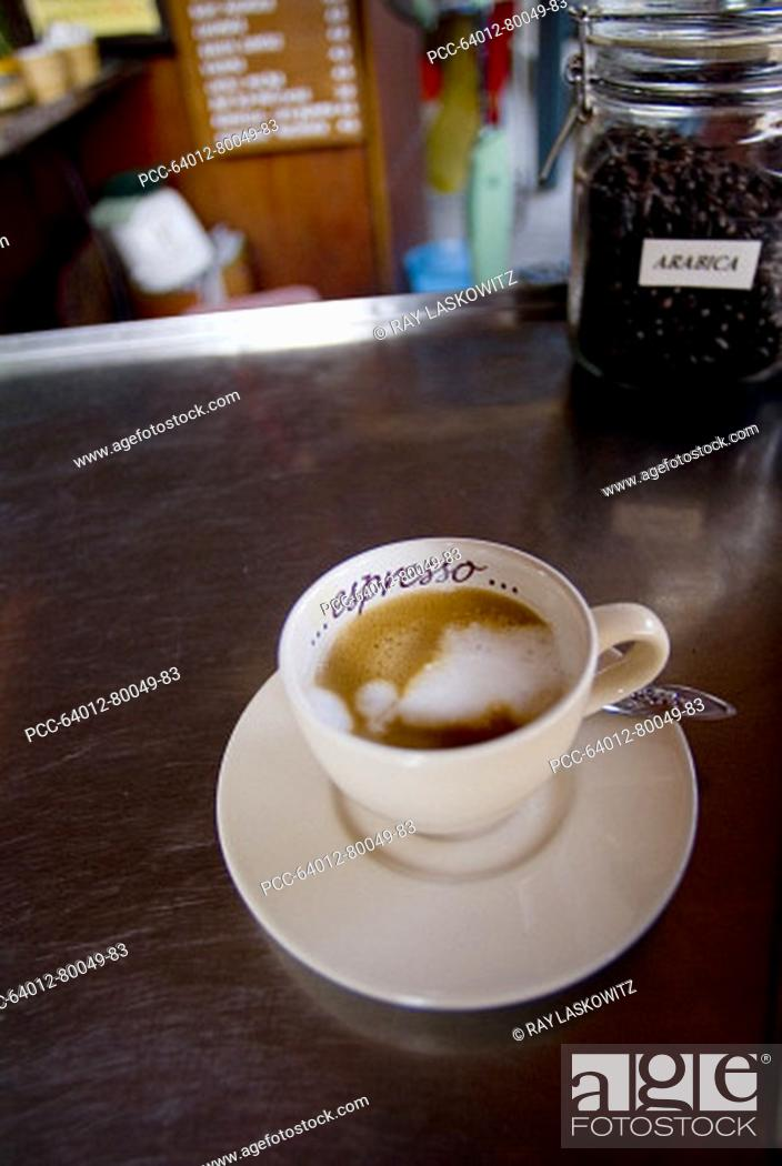 Stock Photo: Thailand, Bangkok, an espresso sitting on the counter of a trendy Thai cafe.