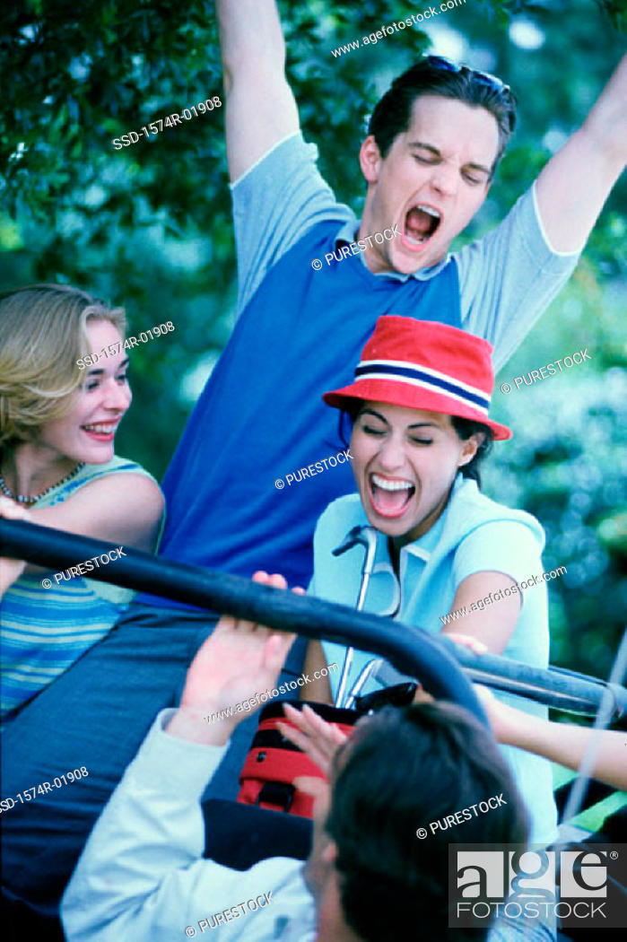 Stock Photo: Two young couples sitting in a car.