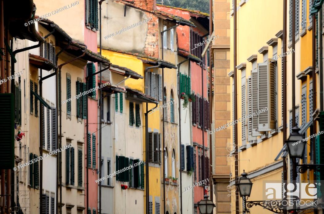 Stock Photo: florence old town alley with lots of colorful facade.