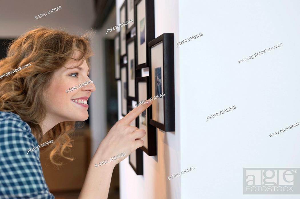 Stock Photo: Interior designer admiring a painting.