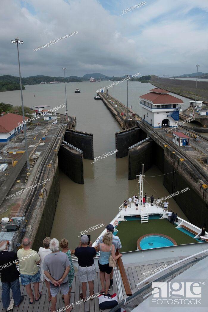 Stock Photo: Ships pass through three sets of locks at the Panama Canal.