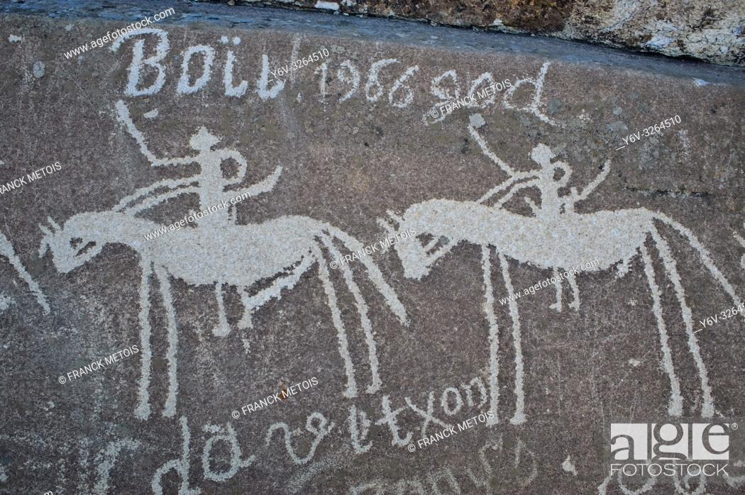 Stock Photo: Petroglyphs degraded by graffiti at Langar ( Wakhan valley, Tajikistan). They are representing horsemen.