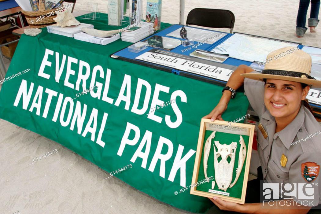 Stock Photo: Female ranger, alligator bones. Everglades National Park display. Earth Day Expo. Lummus Park. Miami Beach. Florida. USA.