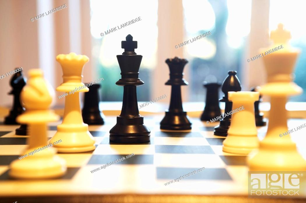 Stock Photo: Chess pieces standing on chess board.