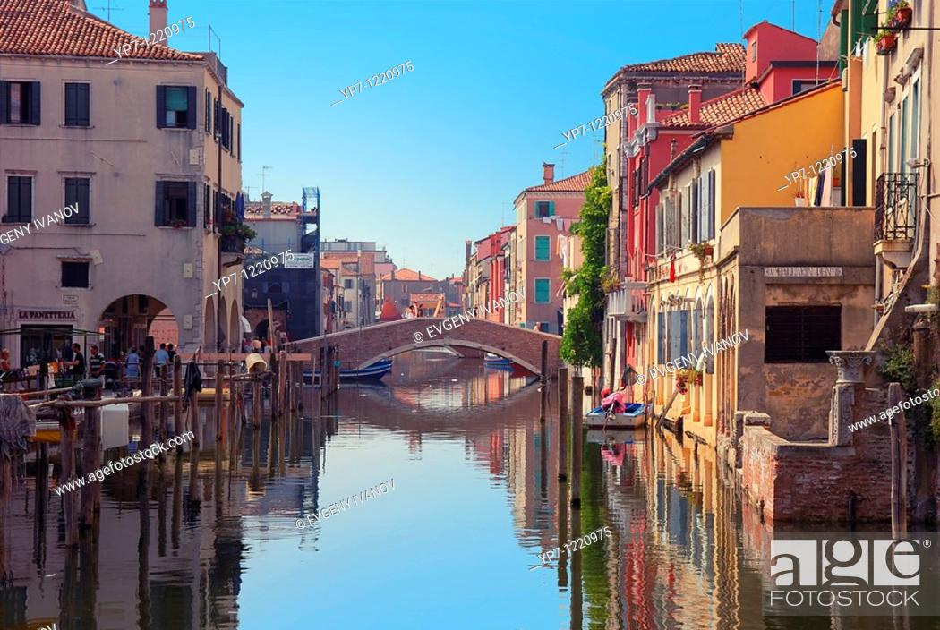 Imagen: Bridge over canal in Chioggia, Italy  Typical Italian houses and gondolas.