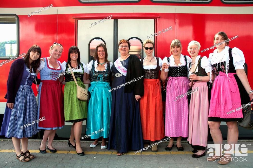 Stock Photo: Young women wearing traditional Bavarian costume, returning home from a pre-wedding or 'hens' party'.