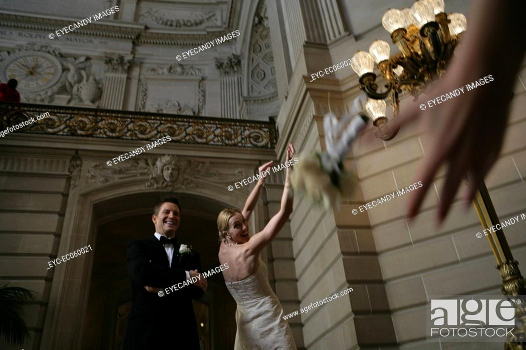 Stock Photo: Bride tossing the bouquet.