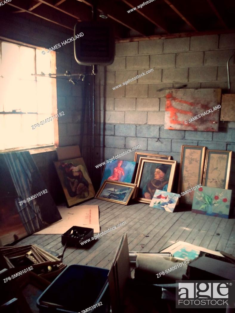 Stock Photo: Paintings found in an attic storage space inside an abandoned building in Vaughan, Ontario, Canada. This building has since been demolished but a property.