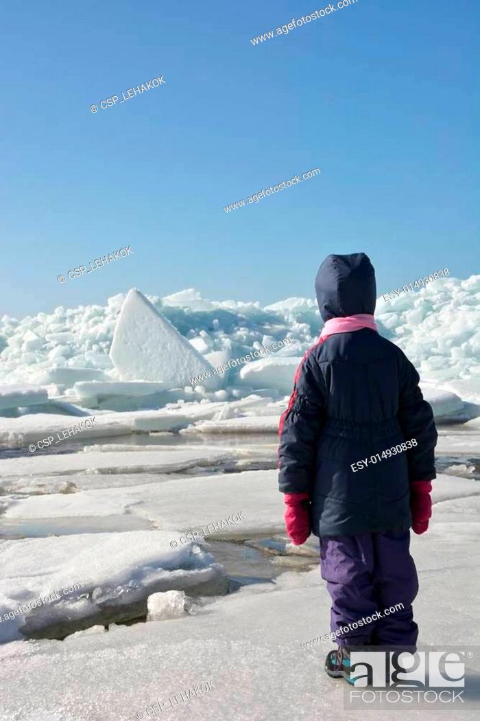 Stock Photo: Little cute girl and Hummock on the frozen sea shore.