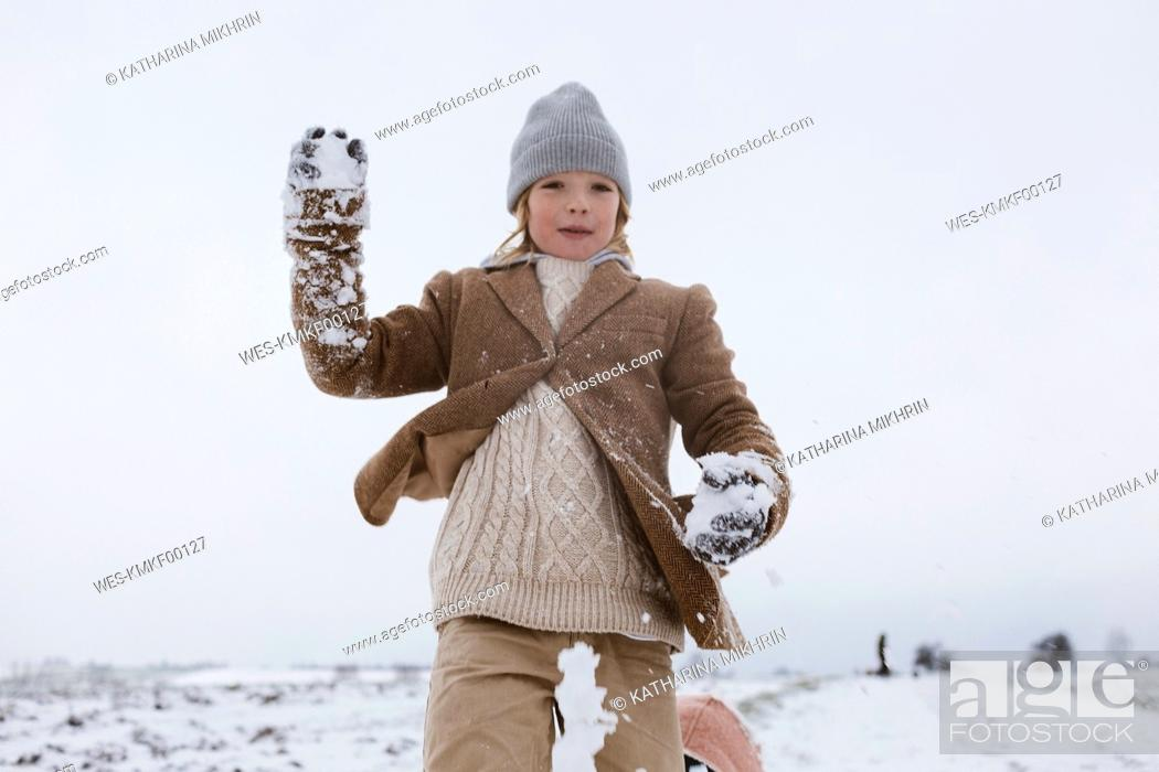 Photo de stock: Happy boy playing with snow.