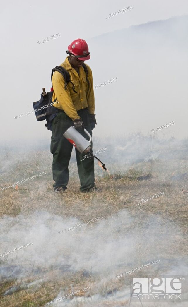 Stock Photo: Shenandoah National Park, Virginia - Workers wearing fire resistant clothing intentionally burn Big Meadows  The National Park Service burns part of the meadow.