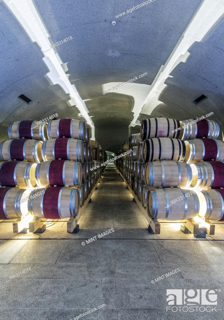 Photo de stock: Barrels of wine aging in wine cellar.