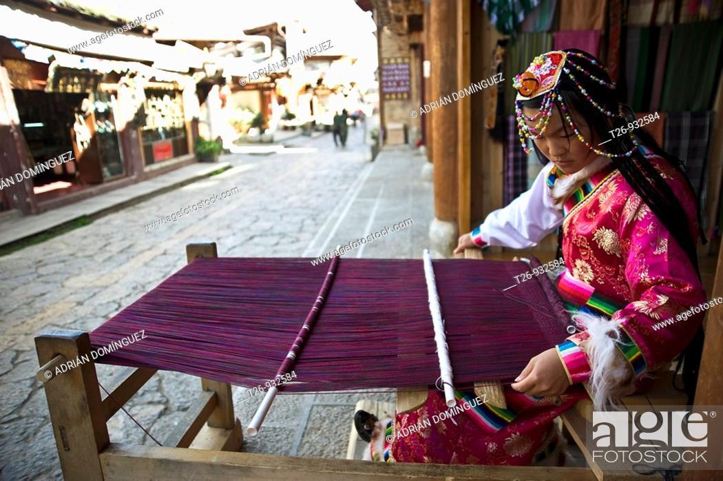 Stock Photo: A woman kniting in a Sangri La street, Yunan province.