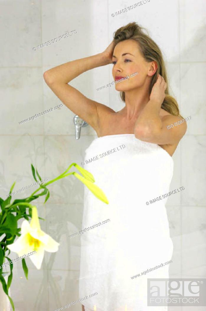 Stock Photo: Woman in bathroom.