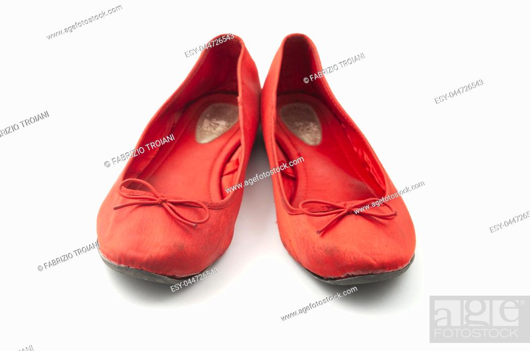 Stock Photo: Old worn ballerina shoes on a white background.