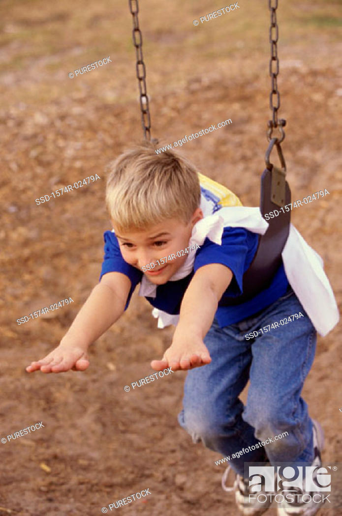 Stock Photo: High angle view of a boy hanging on a swing.
