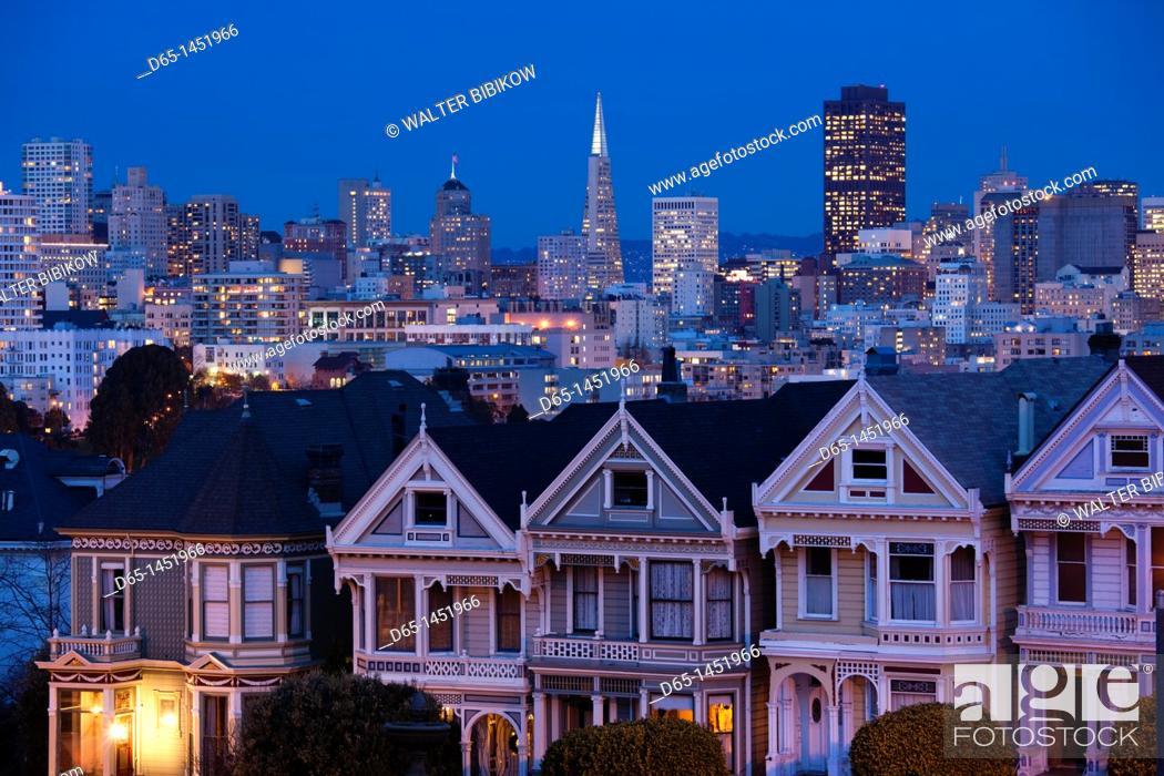 Stock Photo: USA, California, San Francisco, The Haight, houses at Alamo Square, dusk.