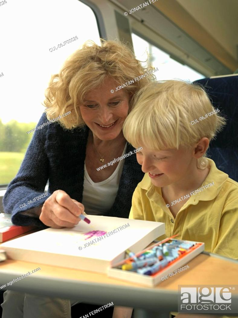 Stock Photo: Grandmother and grandson on train.