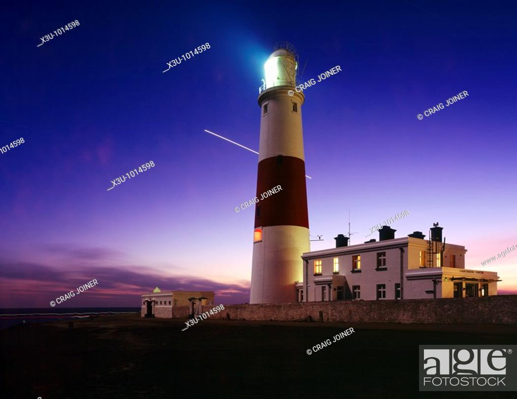 Stock Photo: Portland Bill lighthouse at dusk on the Dorset Jurassic Coast, England, United Kingdom  The planet Venus is seen traversing the night sky during a 1 hour long.