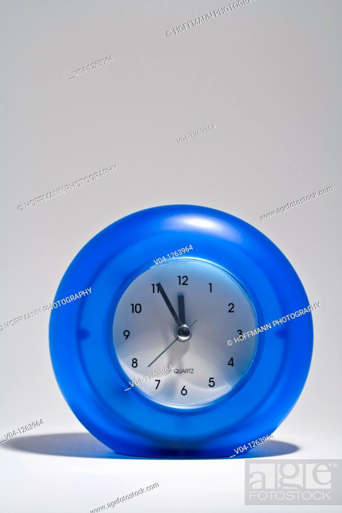 Stock Photo: Close up of a blue alarm-clock.