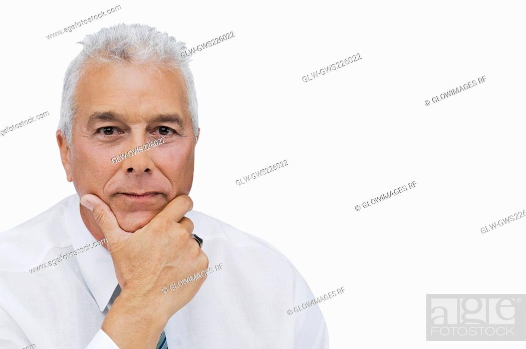 Stock Photo: Portrait of a businessman thinking with his hand on his chin.