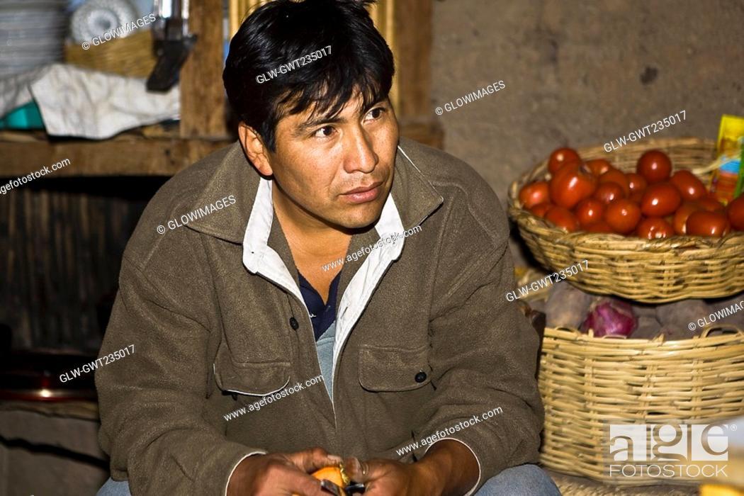 Stock Photo: Close-up of a mature man sitting at a market stall, San Juan de Chuccho, Peru.