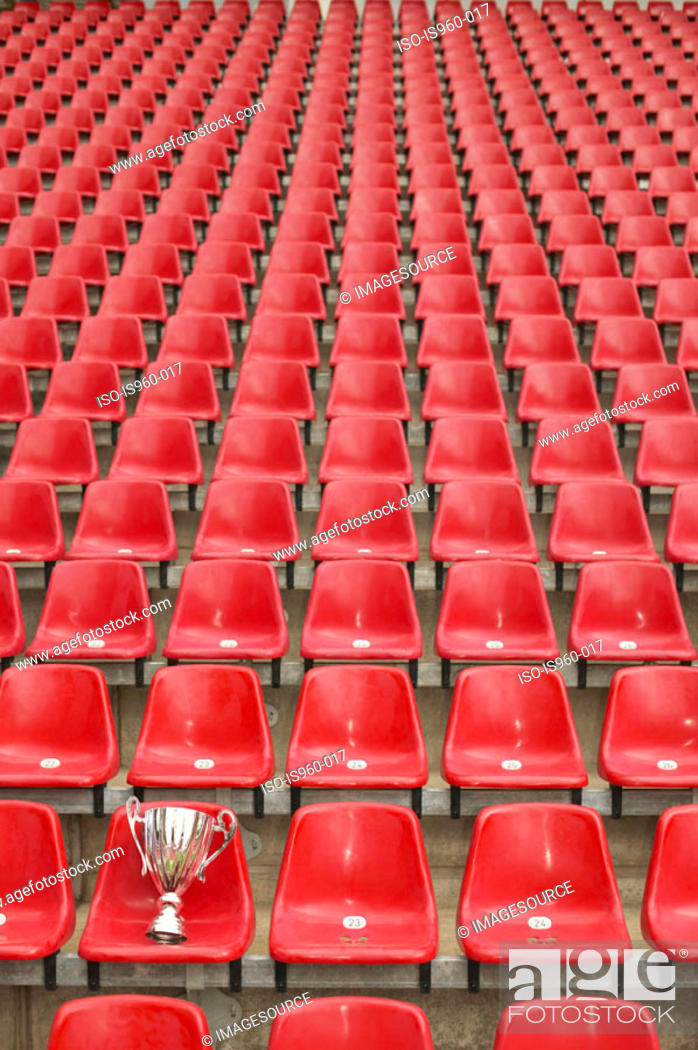 Stock Photo: Trophy left in a football stadium.
