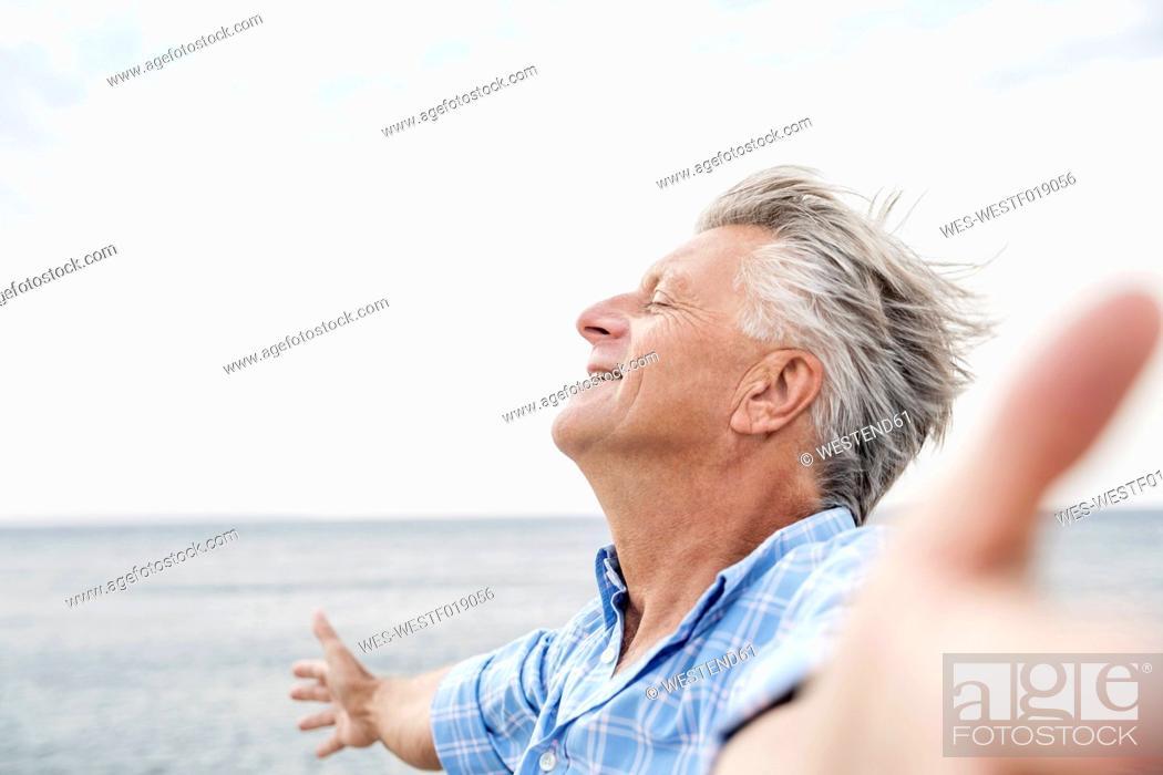 Stock Photo: Spain, Senior man with closed eyes, close up.