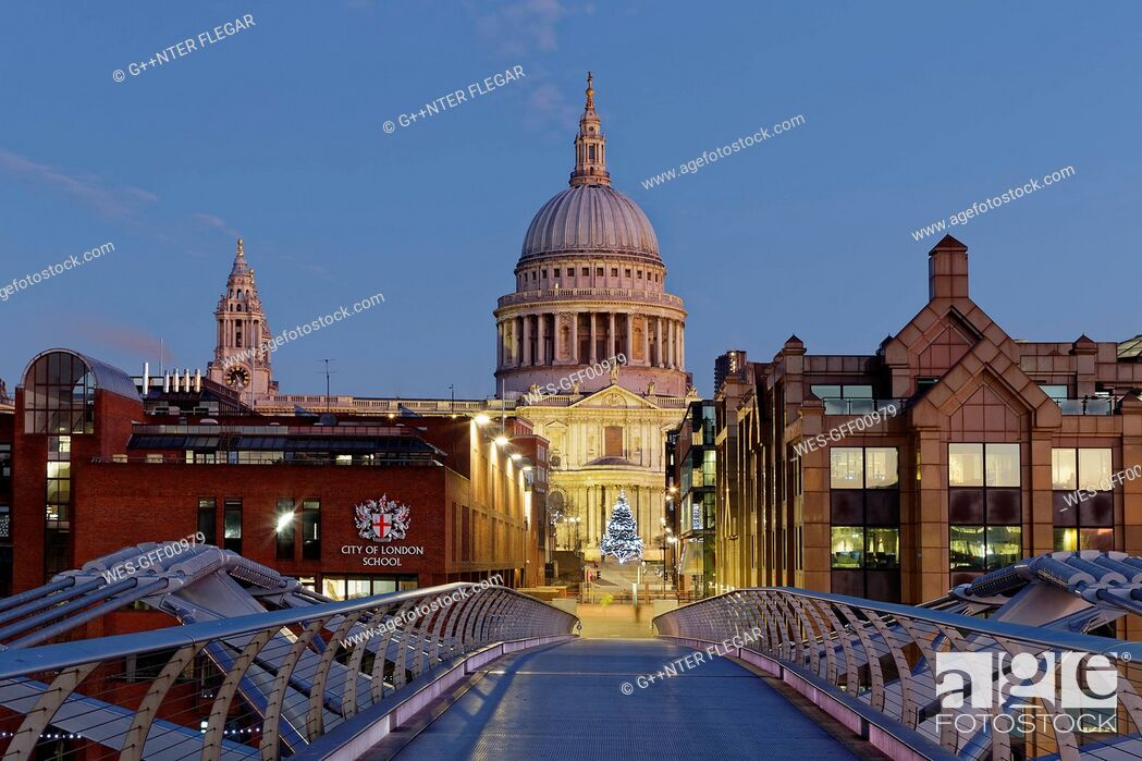 Stock Photo: UK, London, St Paul's Cathedral and Millennium Bridge at dusk.