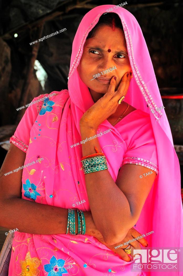 Stock Photo: Woman at souvenir shop at Lakshman Jhula in Rishikesh.