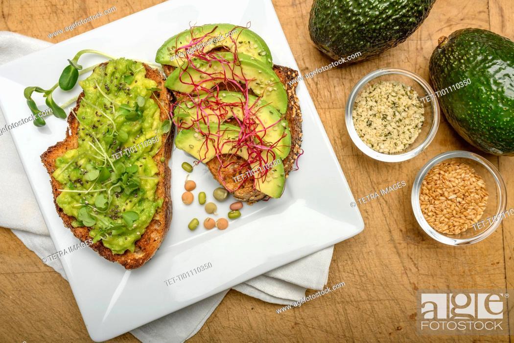 Stock Photo: Avocado and bean sprouts on toast.