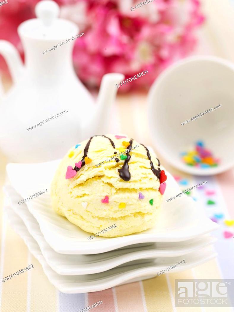 Stock Photo: flower, ice cream, creamer pot, cup, small plate, tablecloth, icecream.