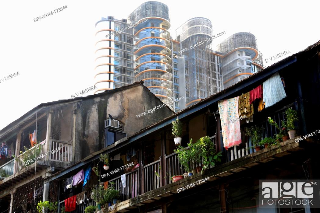 Stock Photo: Old daruwala chawl and skyscraper ; Ganpatrao kadam marg ; Lower Parel ; Bombay Mumbai ; Maharashtra ; India 26-August-2009.