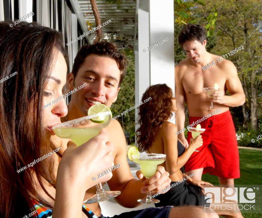 Stock Photo: Young couples drinking margaritas.